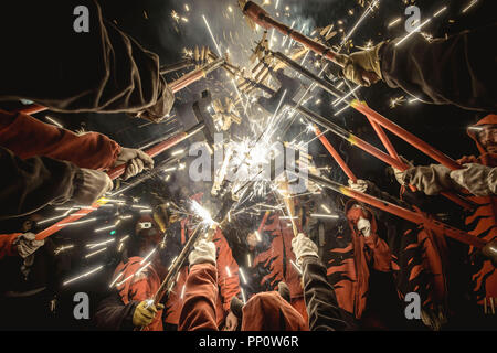 Barcelona, Spain. 22 September, 2018:  'Correfocs' (fire runners) gather to enlighten their fireworks during Barcelona's Fiesta Mayor (main festival), La Merce Credit: Matthias Oesterle/Alamy Live News