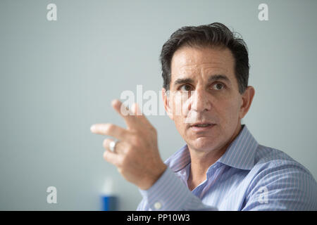 13 September 2018, Baden-Wuerttemberg, Ehningen: Bob Lord, Chief Digital Officer of International Business Machines Corporation (IBM), gestures during a conversation with the German Press Agency. According to the top IBM digital strategist, computers and robots will not make autonomous decisions in the long term. Photo: Marijan Murat/dpa - Stock Photo