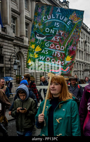 London, UK. 22nd Sep, 2018. 22 September 2018.A woman carries a painted poster with the message 'A Culture Is Only As Good As Its Woods'. Several thousands march through London on The Peoples Walk for Wildlife set up by naturalist and broadcaster Chris Packham to support the People's Manifesto for Wildlife drawn up by him with the aid of 17 independent experts and scientists aimed at halting the drastic decline in British wildlife. The even was supported by many NGOs, schools and environmental activists.  Credit: Peter Marshall/IMAGESLIVE/ZUMA Wire/Alamy Live News Credit: ZUMA Press, Inc./Alam - Stock Photo