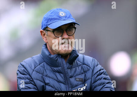 London Stadium, London, UK. 23rd Sep, 2018. EPL Premier League football, West Ham United versus Chelsea; Chelsea Manager Maurizio watches the Chelsea players during pre match warm up from the touchline Credit: Action Plus Sports/Alamy Live News Stock Photo