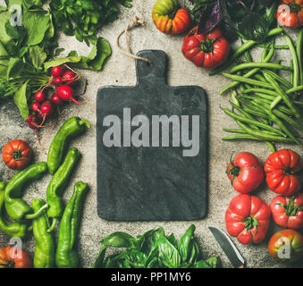 Healthy food background with seasonal vegetables and greens, copy space - Stock Photo