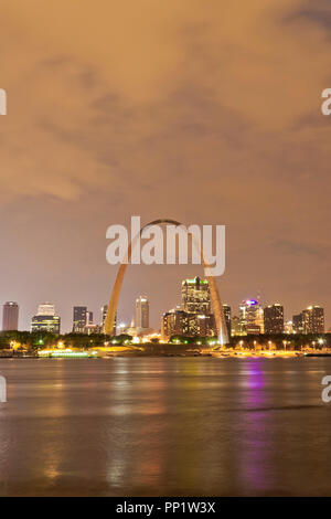 Clouds beyond Downtown St. Louis as seen from across the Mississippi River from the east riverfront in East St. Louis, Illinois. - Stock Photo