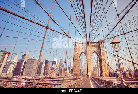 Brooklyn Bridge at sunrise, vintage stylized picture, New York City, USA. - Stock Photo