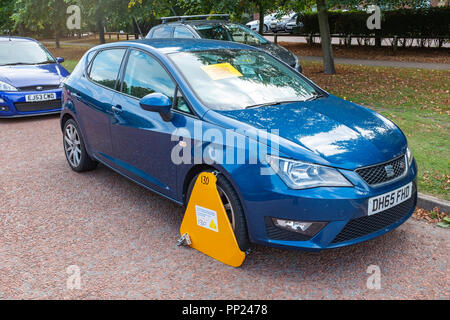 Clamped untaxed vehicle in Crewe Cheshire UK - Stock Photo