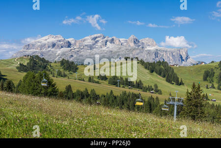 Alta Badia ski area in the summer with the Sella Group mountains in the background, Dolomites, Italy - Stock Photo