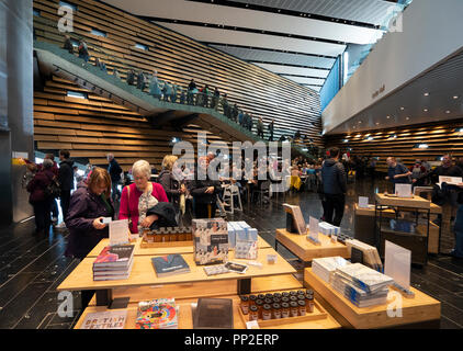 Visitor shop at  the new V&A Museum on first weekend after opening in Dundee , Scotland, UK. - Stock Photo