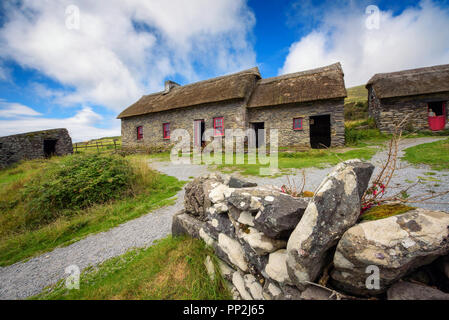 Fahan, Ireland - August 3, 2018 : Slea Head Famine Cottages built in the mid nineteenth century housing people through one of the worst famines in Wes