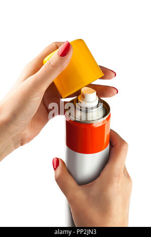 Aluminum spray can with plastic cap on hand with white backgroun - Stock Photo