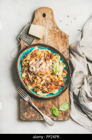 Italian traditional pasta dinner with tagliatelle bolognese, top view - Stock Photo