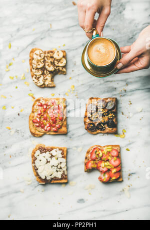 Healthy breakfast with wholegrain toasts , woman's hands with coffee - Stock Photo