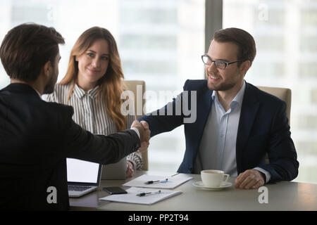 Business partners handshaking greeting at meeting in office - Stock Photo