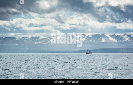 Icelandic fishing boat for whale watching on open water in Husavik, Iceland. - Stock Photo
