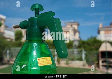 A plant spray which relies on air pressure for spraying plants and trees with insecticides - Stock Photo