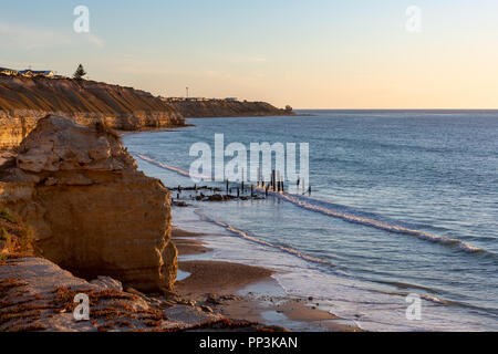 Sunset at the iconic Port Willunga Jetty ruins looking down from the cliff  face in South Australia on 22nd September 2018 - Stock Photo
