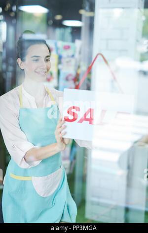 Shopkeeper Hanging Sign - Stock Photo