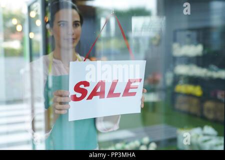 SALE Sign on Shop Window - Stock Photo