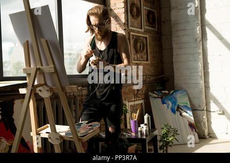 Modern Artist in Workshop - Stock Photo