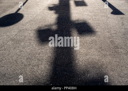 Berlin, Germany, August 31, 2018: Close-Up of Shadow of Lamp Post and Traffic Sign - Stock Photo