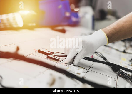 Checking the wiring systems on the control desk, automotive industry - Stock Photo