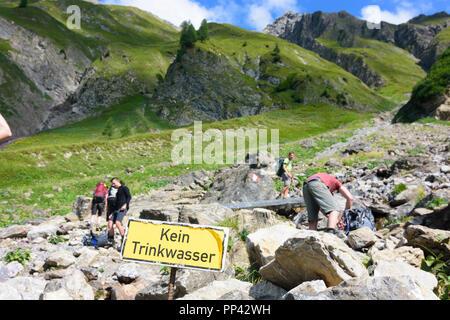 Lechtaler Alpen, Lechtal Alps: sign 'Kein Trinkwasser' at stream, TirolWest Region, Tirol, Tyrol, Austria - Stock Photo