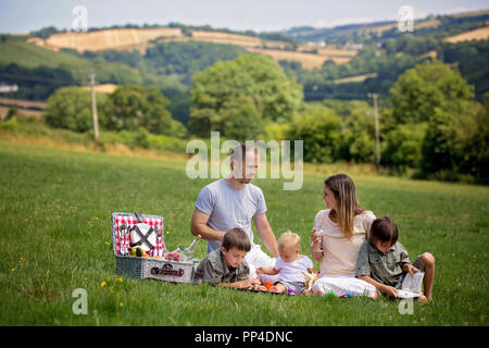 Happy family, having picnic in the rural, aerial view of Devonshire, summertime - Stock Photo