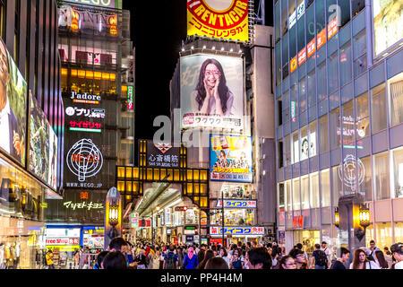 Osaka, Japan - Sep 20th 2018 - Big group of people walking in an open air shopping in Osaka downtown, near Ebisu bridge, Osaka Japan - Stock Photo
