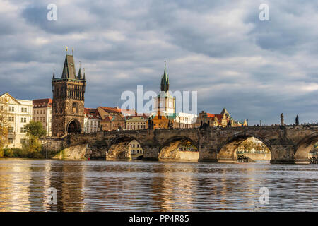 Scenic spring sunset view of the Charles Bridge over Vltava river in Prague, Czech Republic - Stock Photo