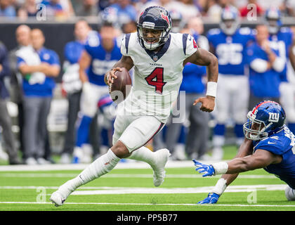 Houston, TX, USA. 23rd Sep, 2018. Houston Texans quarterback Deshaun Watson (4) runs with the ball during the 4th quarter of a NFL football game between the Houston Texans and the New York Giants at NRG Stadium in Houston, TX. The Giants won the game 27 to 22. Trask Smith/CSM/Alamy Live News - Stock Photo
