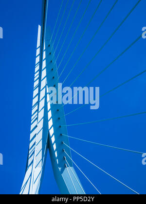 Image of part of a Erasmus bridge with a blue sky background in Rotterdam in the Netherlands Holland - Stock Photo