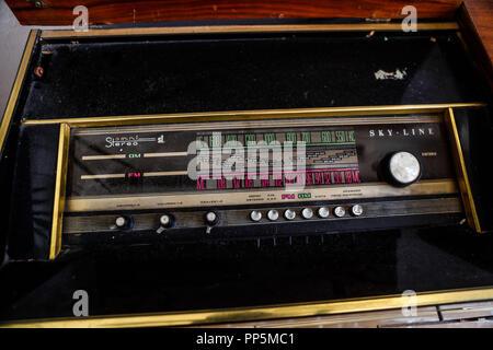 Classic Vinyl Record Player With Radio. AM radio, FM, Tune frequency of radio stations. Knob, knobs. Interior decoration of the Lola Vuela coffee shop - Stock Photo