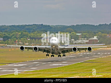 Airbus Industrie Airbus A380-841 demonstrator taking off from the runway at Farnborough. - Stock Photo