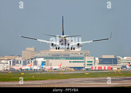 Ryanair Boeing 737-8AS aircraft landing at London Gatwick airport. - Stock Photo