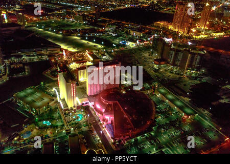 Las Vegas, Nevada, United States - August 18, 2018: aerial view of Las Vegas Strip and Skyline illuminated by night. Scenic flight above: Circus Circus and Downtown of cityscape. - Stock Photo