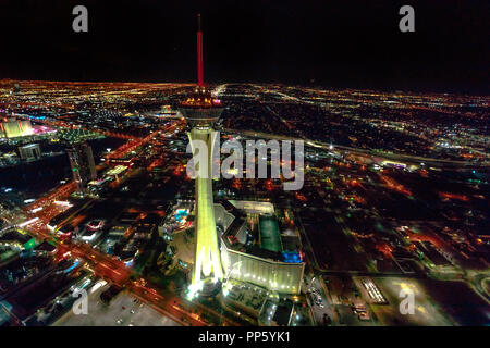 Las Vegas, Nevada, United States - August 18, 2018: aerial view from scenic flight of Las Vegas by night. Stratosphere Casino, Hotel and Tower in Downtown cityscape. Las vegas nightlife. - Stock Photo