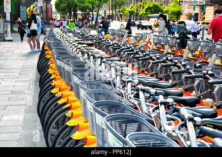 Many bicycles for rent lined up next to each other in the city of Taipei, Taiwan. - Stock Photo