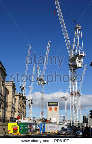 Cranes standing over the St James Centre demolition and redevelopment, view towards Leith Street from Waterloo Place, Edinburgh Scotland - Stock Photo