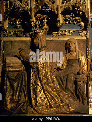 Spain. Castile and Leon. Burgos. MIraflores Charterhouse. Altarpiece which  was carved in 1496-1499 by Castilian sculptor of Flemish origin Gil de Siloe (1440-1501), and polychromed and gilded by Diego de la Cruz (1482-1500), a Flemish origin painter.  Detail of Isabel of Portugal, queen consort of Castile, 1447-1454, praying and protected by her patron Saint ( St. Elizabeth). - Stock Photo
