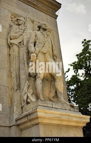New York City, NY; June 2017: A George Washing statue with the Washington Arch in Washington Square Park, NYC - Stock Photo