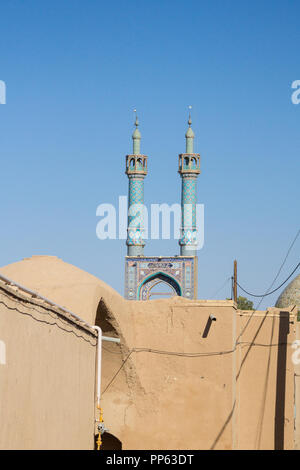 Jameh mosque, with its distinctive tiles minarets, seen from a nearby street. Jameh mosque is one of the symbols of the city of Yazd, in the middle of - Stock Photo