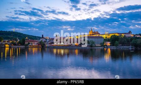 Panorama view of Prague city skyline in Czech Republic at night. - Stock Photo