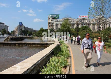 BUCHAREST, ROMANIA - AUGUST 19: People visit Piata Unirii square on August 19, 2012 in Bucharest, Romania. In 2009 Bucharest was the 21st most visited - Stock Photo
