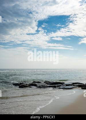 Jetty at ocean beach in Westhampton Beach, the Hamptons, Long Island, New York, USA. - Stock Photo