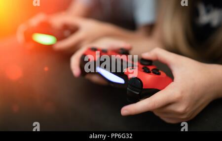 Children playing video games - Stock Photo