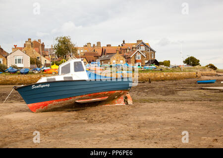 Small fishing boats on the beach at low tide in the Aln estuary at the seaside fishing village of Alnmouth Northumberland England UK - Stock Photo