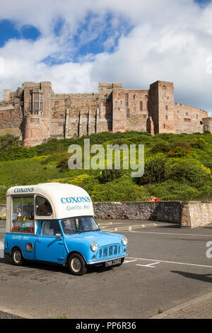 Austin Morris Mini car van converted to an ice cream van parked in front of Bamburgh castle Northumberland England UK - Stock Photo