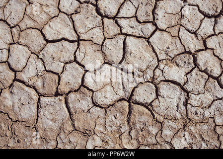 Textured background of cracked dry brown earth - Stock Photo