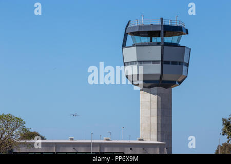Military Airport, Royal Australian Air Force Base Amberley new control tower, a C17 Globemaster taking off to the left of the tower. - Stock Photo