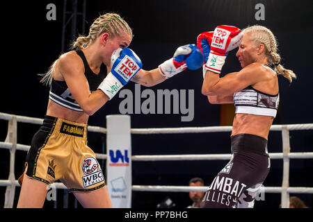 Czech professional boxer Fabiana Bytyqi (left) defeats Denise Castle (GBR) in their Minimumweight boxing match for WBC female World Championship title at the Professional Boxing Live event in Usti nad Labem, Czech Republic on September 22, 2018. (CTK Photo/Ondrej Hajek) - Stock Photo