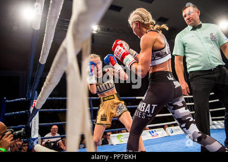 Czech professional boxer Fabiana Bytyqi (left) defeats Denise Castle (GBR) in their Minimumweight boxing match for WBC female World Championship title at the Professional Boxing Live event in Usti nad Labem, Czech Republic on September 22, 2018. (CTK Photo/Ondrej Hajek) - Stock Photo