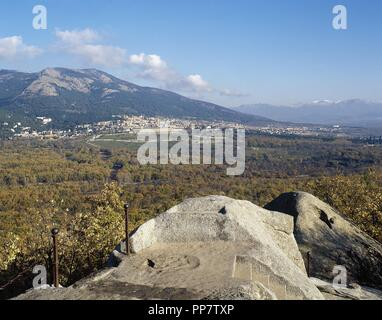 Spain. Community of Madrid. Panorama of San Lorenzo de El Escorial and the Monastery of El Escorial from the Chair of Philiph II, digging in granite rock where the monarch followed the progress of work of the monastery. - Stock Photo